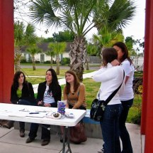 Photo of students at a table outside in Texas