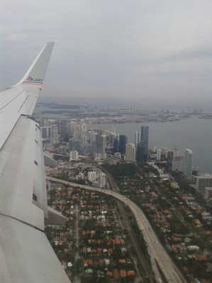 Photo of view out airplane flying over Miami