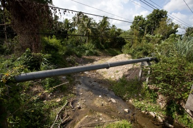 Arsenic-contaminated stream and pipe for non-contaminated water
