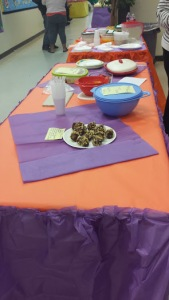 One of the many tables displaying parents' dishes for the nutrition competition.