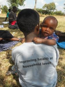 Village Health Team member Stella and her son