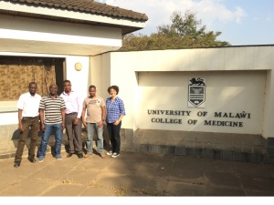 My fellow labbies, from left: Godfrey, Alex, Andrew, Chifundo, and me, standing at the entrance of the University of Malawi College of Medicine. The ICEMR Molecular and Genomics Core Lab where we all worked is housed in the Biochemistry Building of the College.